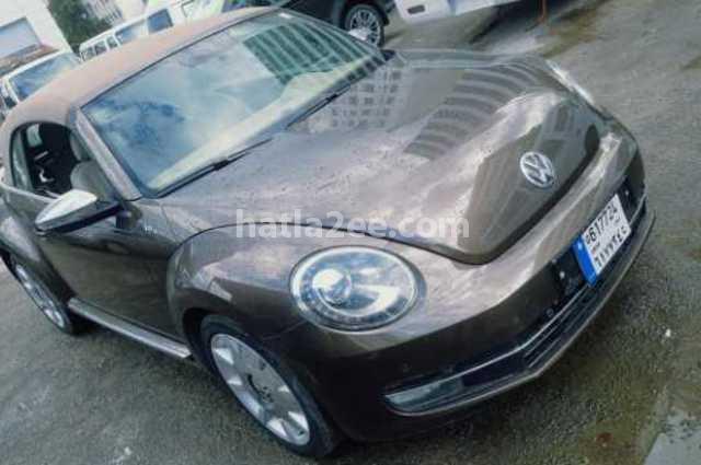 Beetle Volkswagen ذهبي