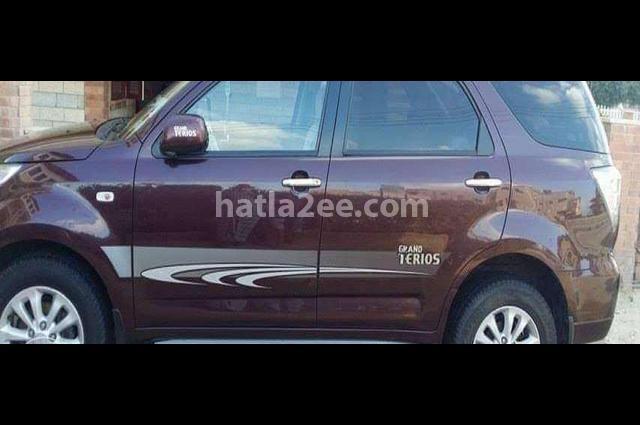 Grand terios Daihatsu Dark red