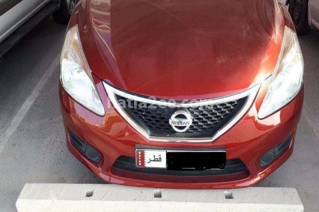 Tiida Nissan احمر غامق