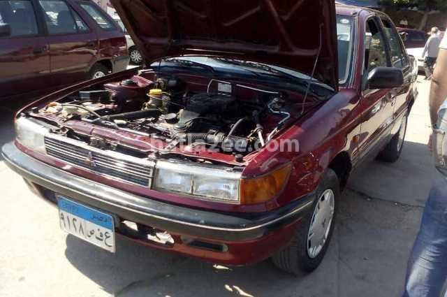 Lancer Mitsubishi احمر غامق