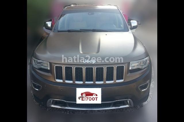 Grand Cherokee Jeep ذهبي