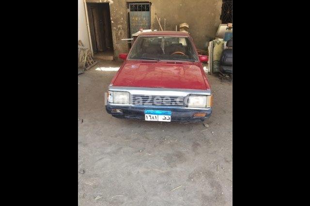 323 Mazda احمر