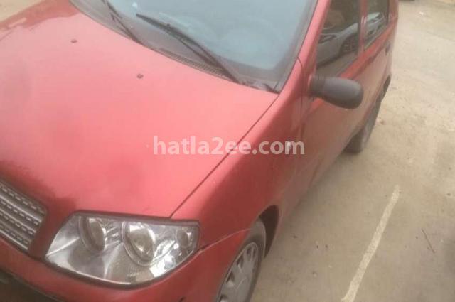 Punto Fiat احمر غامق