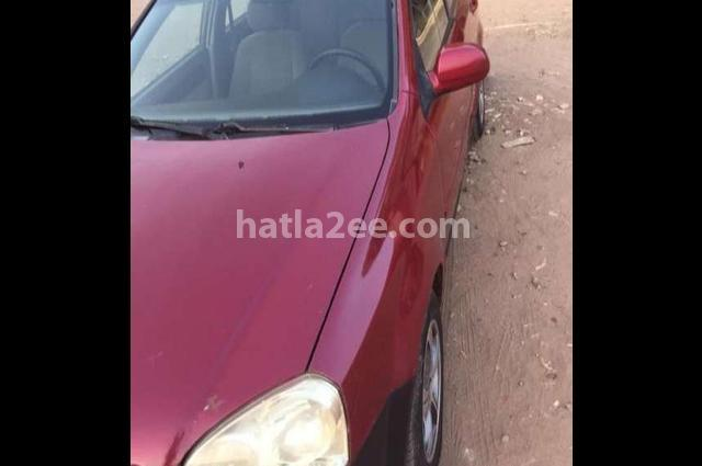 Optra Chevrolet احمر غامق
