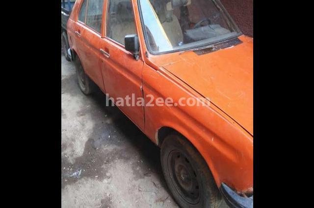 104 Peugeot برتقالى
