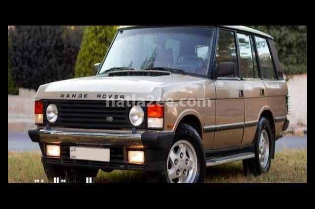 Vogue Land Rover ذهبي
