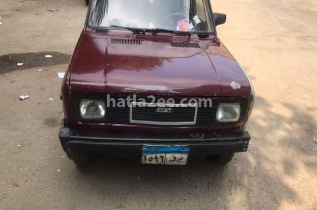 128 Fiat Dark red
