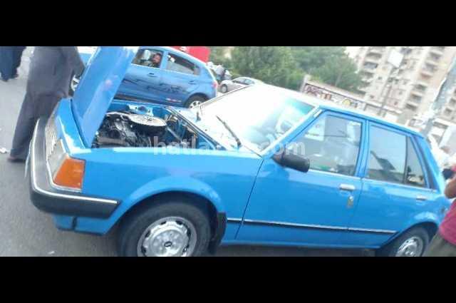 323 Mazda أزرق