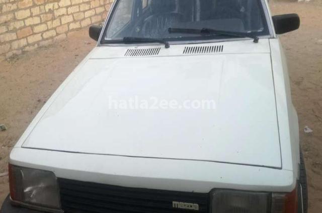 323 Mazda أبيض