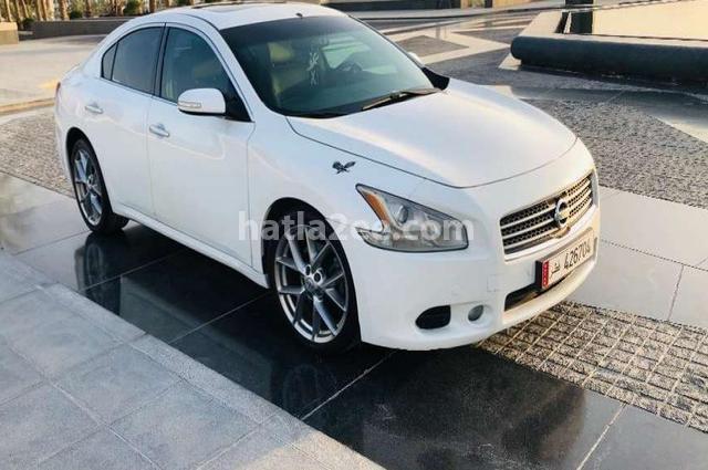 Maxima Nissan أبيض