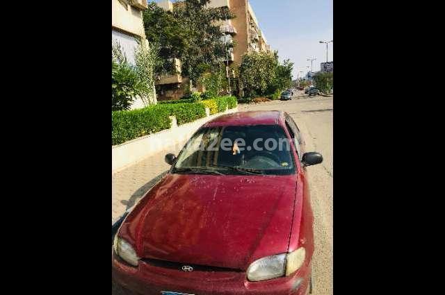 Accent Hyundai احمر غامق