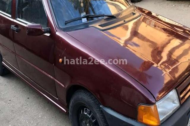 Uno Fiat احمر غامق